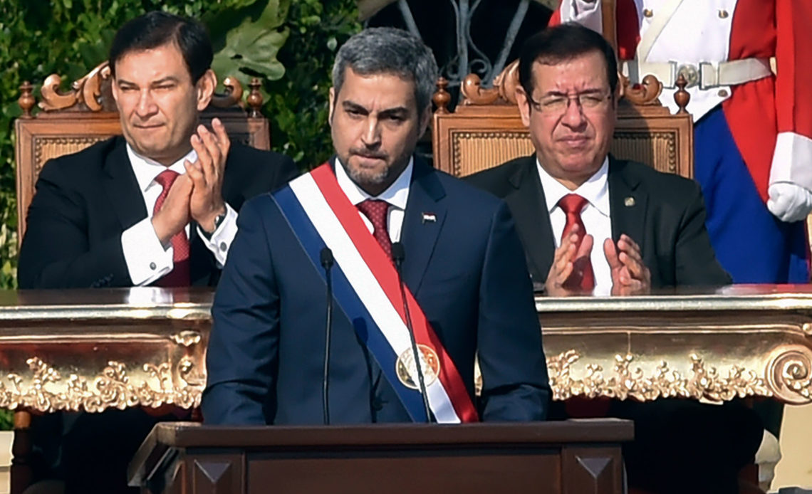 Paraguay's new President Mario Abdo Benitez (C) delivers a speech after being sworn-in, in Asuncion, on August 15, 2018. Mario Abdo Benitez, of the right-wing Colorado party, was sworn-in Wednesday as President of Paraguay, with the challege of getting to agreements with the opposition. / AFP PHOTO / NORBERTO DUARTE